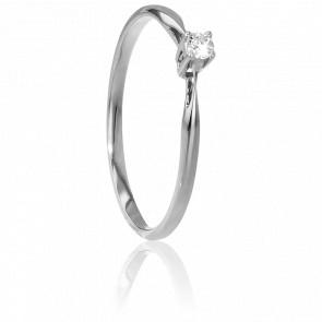Solitario de oro blanco y diamante de peso 0,04 quilates